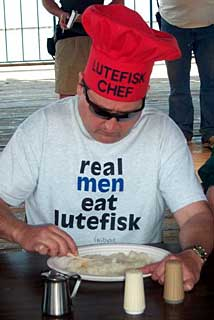 Man eating lutefisk